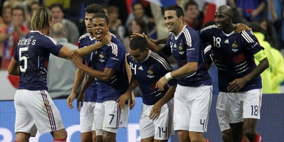 581344_french-players-celebrate-after-scoring-against-romania-during-their-euro-2012-qualifying-soccer-match-in-saint-denis.jpg
